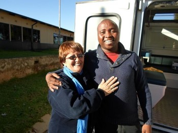 Volunteer Tannie Linda Burger with Amos on site at Diepsloot