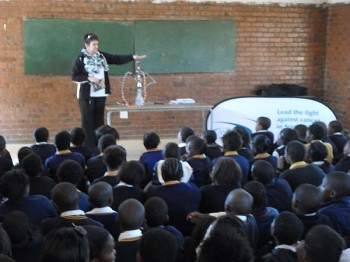 Community Mobiliser, Silvia Craucamp educating scholars on the dangers of the hookah pipe