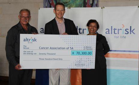 Munnik Marais (left) & Magdalene Seguin (right), CANSA, receive the donation from Altrisk's MD Michael Blain