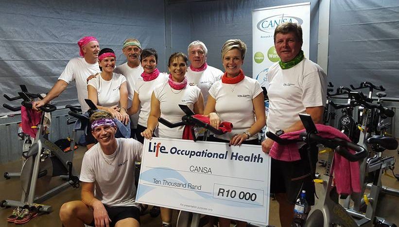 Navarre Kruger, front left, (Lead Coordinator team) receives R10 000 cheque from Life Occupational Health the team's 1st sponsorship to date.